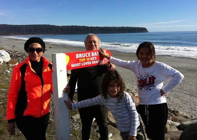 Marie Mahuika, left, Upoko Rūnanga Richard Wallace, and our tamariki Hāriata Russell and Karera Wallace-Jones with Heretaniwha and our new sign.