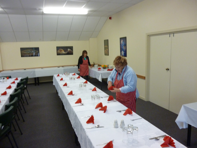 Mateka Pirini (front) and Tui Puki setting up the hall for the graduation dinner.