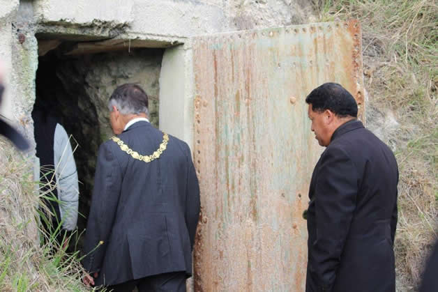 Mayor, Dave Cull entering the cave with elders of Ngā Ruahine.