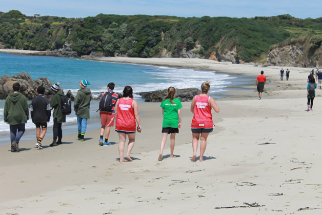 Members of the camp strolling along one of the lovely beaches on Rakiura.