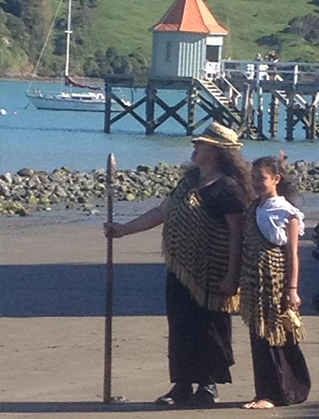 Meri Robinson (representing her great-grandmother Puai) delivering the karanga and alongside her is Marama Poharama-King who represented her great-grandmother for whom she is named, Mere Whariu and Puai's daughter.