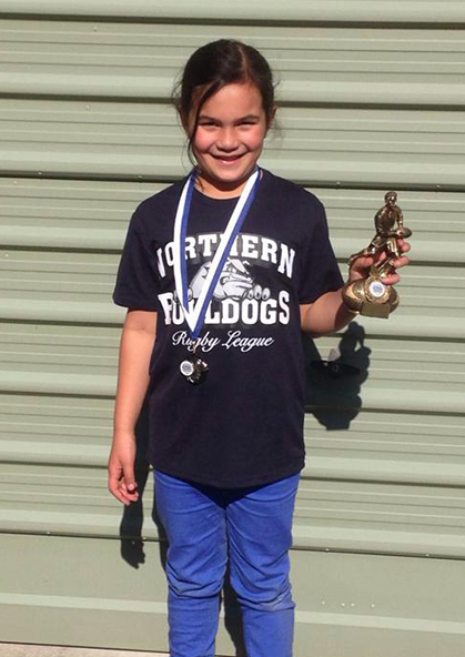 Metua with her sportsmanship trophy.