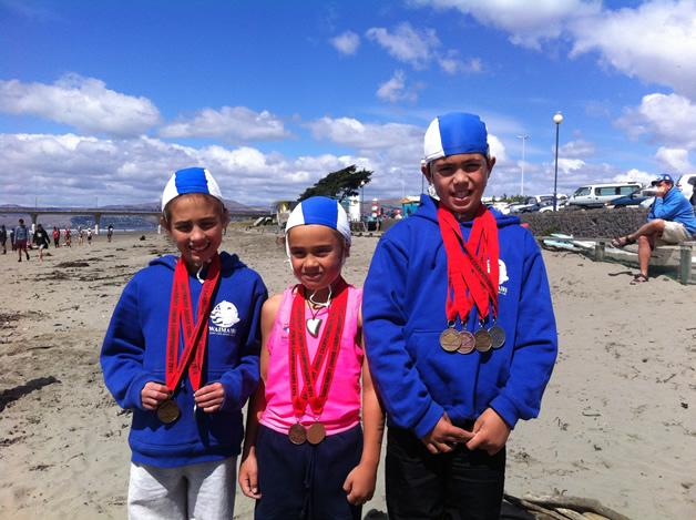 Mihiroa Pauling, Meihana Pauling and Te Kaio Cranwell with their medals.