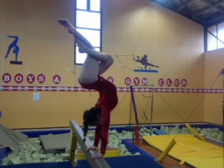 Millie practices at her gymnastics club.
