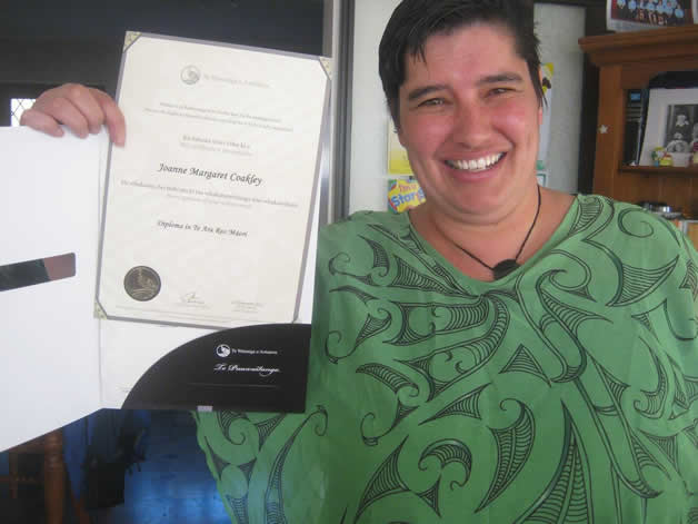 Millie with her diploma.