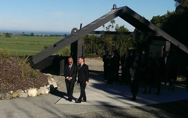 Minister for Treaty of Waitangi Negotiations, Christopher Finlayson being led onto Tūhuru Marae.
