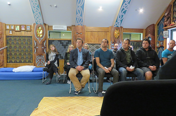 Ngāi Tahu Tourism regional general manager – southern, David Kennedy with Hollyford and Guided Walks staff being welcomed to Te Tauraka Waka.