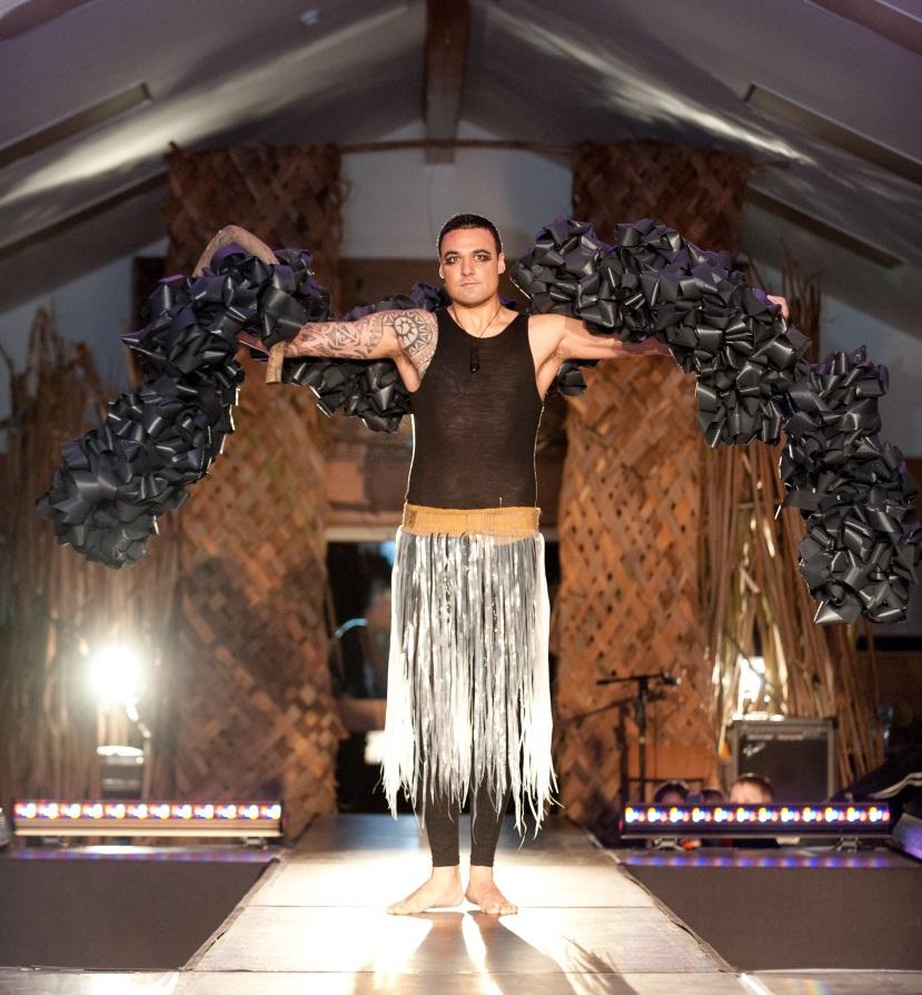 Nick Price-Ellison modelling 'Māui – A Modern Man', by Rowan Holt.