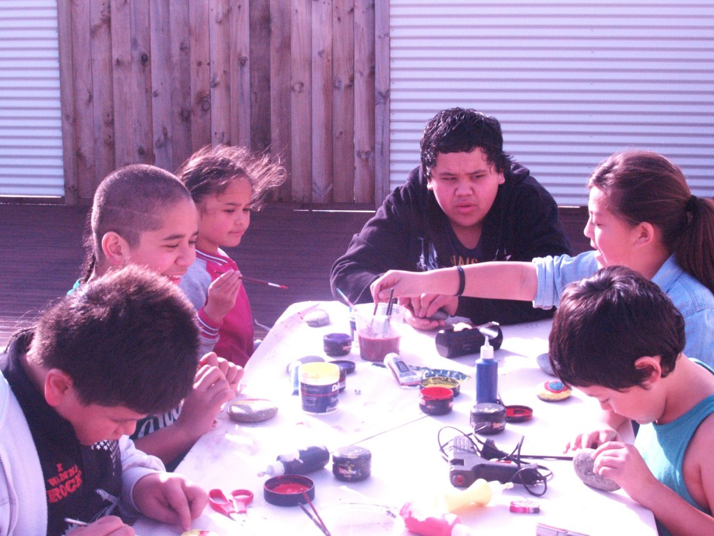 Our tamariki painting river stones and learning their pepeha.