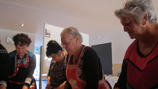Our whānau hard at work in the kitchen.