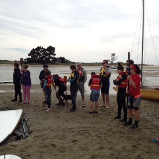 Participants lining up to get in the water at the Te Reo and Waka Fun Day.