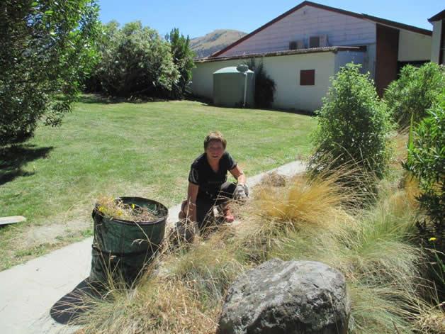 Patty-Anne Oberst weeding back garden.