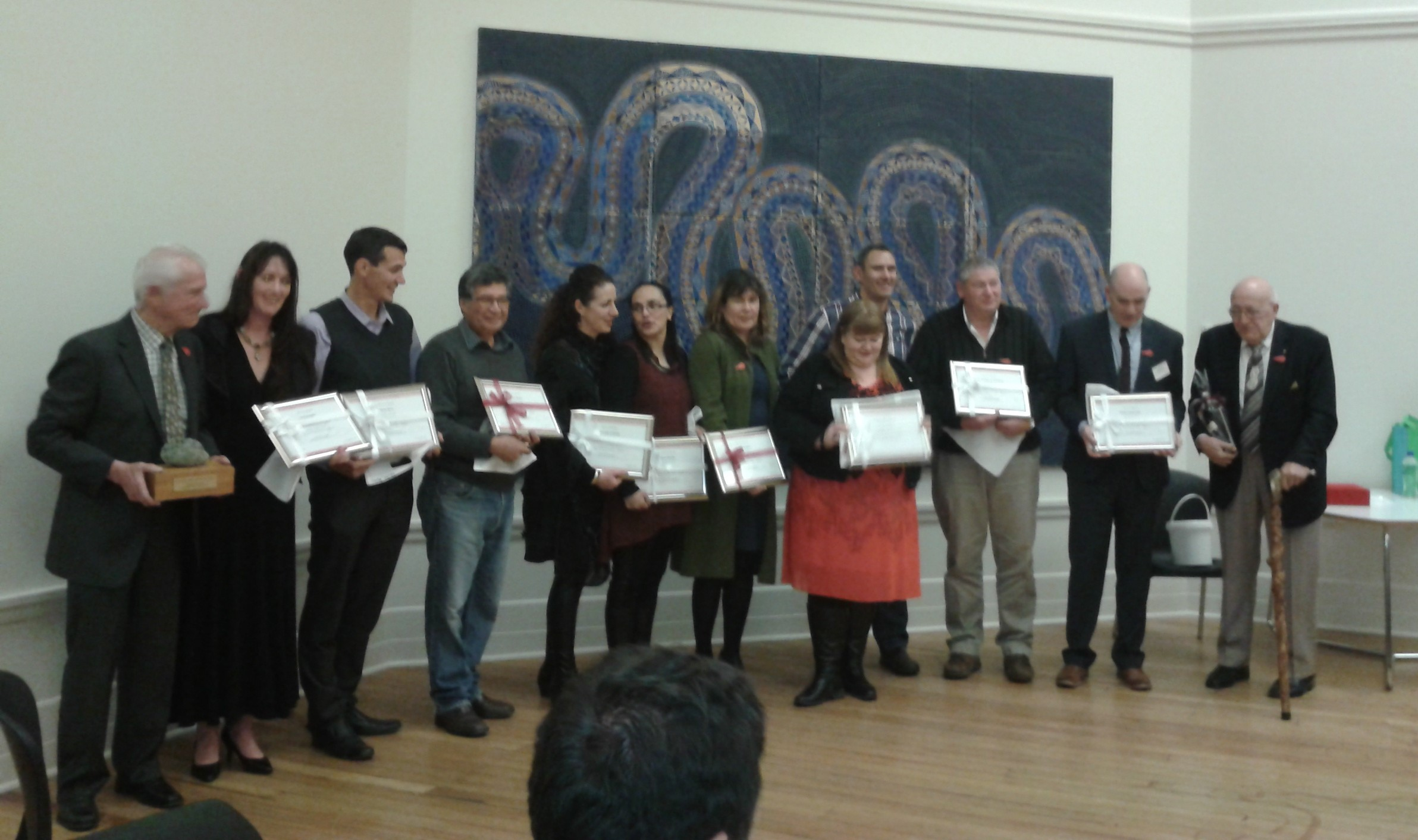 Phil Broughton, Rebecca Williams and Janine Kapa receiving (with others) 10 year participation certificates at the receive KUMA hui in Dunedin.