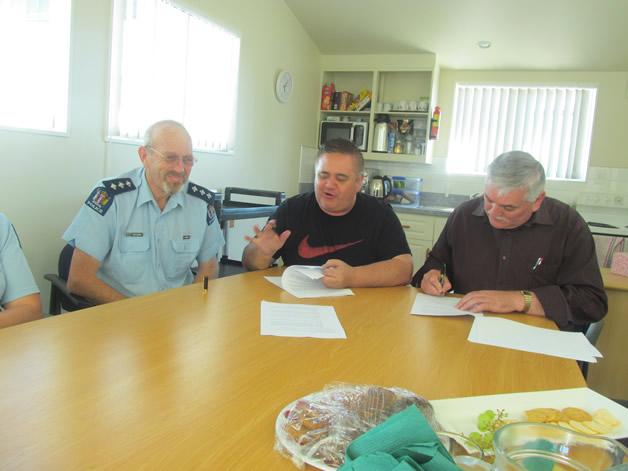 Inspector John Canning and Poutini rūnanga chairs, Francois Tumahai and Paul Madgwick, sign the reviewed Memorandum of Agreement between NZ Police and the rūnanga.