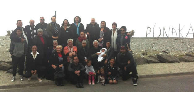 Poutini Ngāi Tahu (Waewae and Makaawhio) pose on the beach after the official opening at Punakaiki.