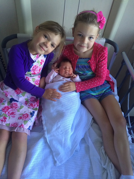 Proud big sisters Niamh and Aoife with Ciara Goldsmith.
