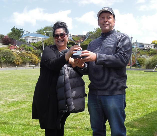 Puketeraki chair, Matapura Ellison, presents the Te Wera/Moki Cup to Ōtākou chair Donna Matahaere-Atariki.