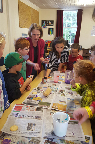 Rachael Jenkins (centre) with Art class students showing how to decorate their biscuits.