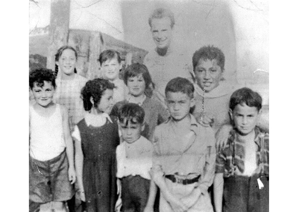 From left, back row: Mariata Couch, Pamela Couch, Maria Couch, Teacher, Billy Hutana. From left, front row: Henry Couch, Suzy Rehu, Johnny Rehu, Moeroa Tauwhare, Melville Rehu.