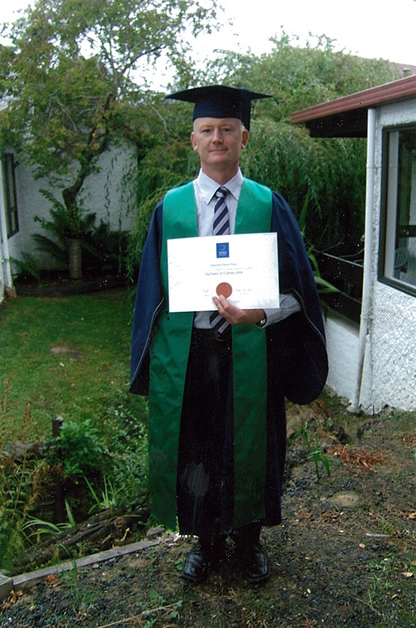 Raymond  with his degree. copy