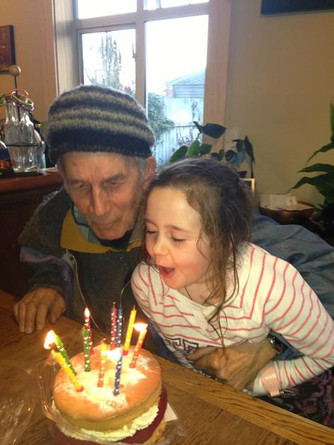Reg Nicholas and granddaughter Poppy enjoying birthday celebrations.