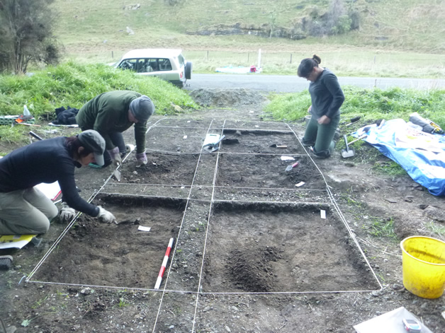 Removing cultural material from an excavation site.