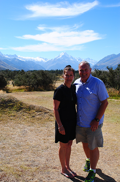 Rowena and husband Mike at the graduation ceremony with Aoraki in the background.