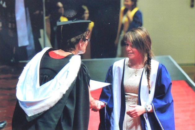 Sarah Thomas receiving her diploma.