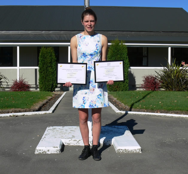 Sarah Thomas with her two awards - New Zealand RFL First Female and Woodhouse Class Platoon Top Student Award 2 Platoon.