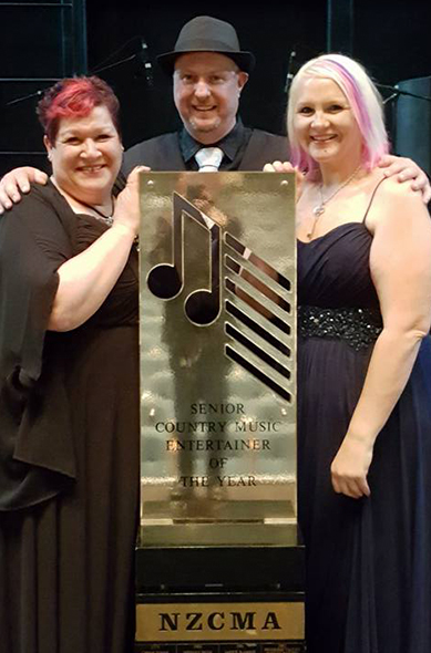 Sharon Russell, Shane Keating, Gina Keating with their trophy at NZ Country Music Entertainer of the Year.