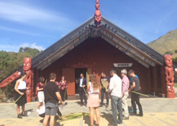 Staff participating in a harakeke weaving wānanga.