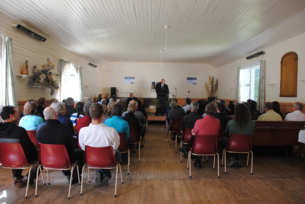 Tā Mark Solomon addresses invited guests in Kaituna Hall.