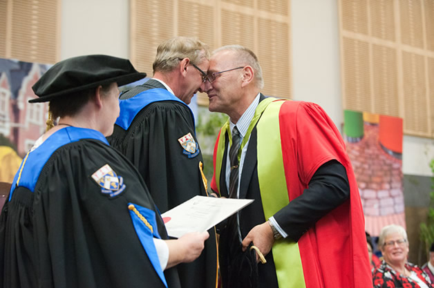 Tā Mark receiving his Doctorate Investiture.