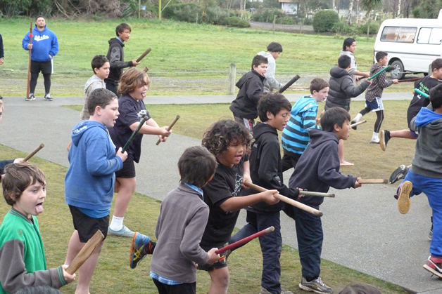 Taiaha tamariki showing their parents what they had learnt throughout the wānanga.