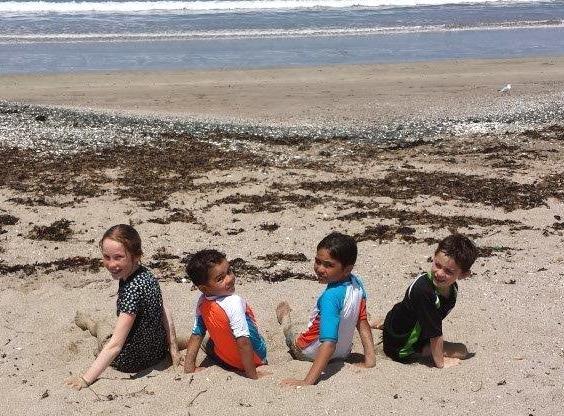 Taiaroa and Ella McDonald and their two cousins Kingston and Harlen Mauger at Ōākura Bay North of Whangarei.
