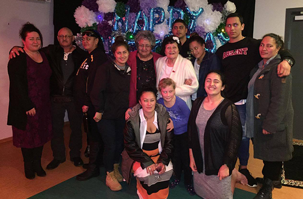 Taina (centre) with some of the whānau and friends during the night.