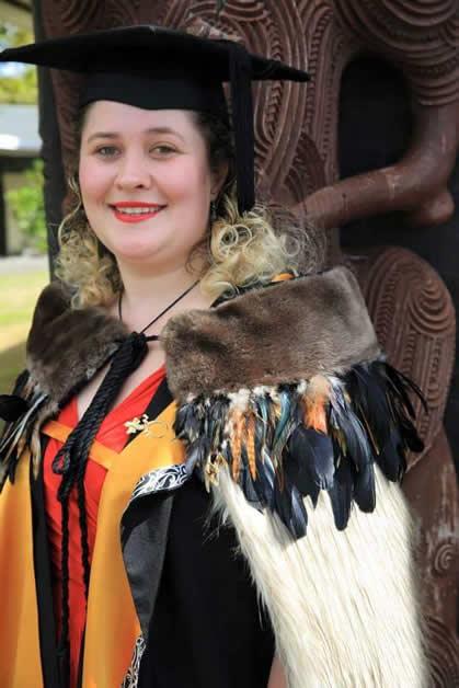 Tamara wearing her family korowai at her graduation.