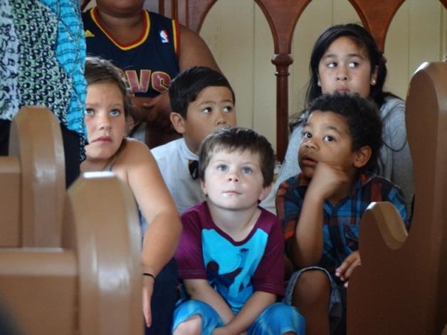 Tamariki listening to the stories at Hone Wetere Church.