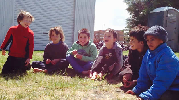 Tamariki playing together at the taiaha wānanga.
