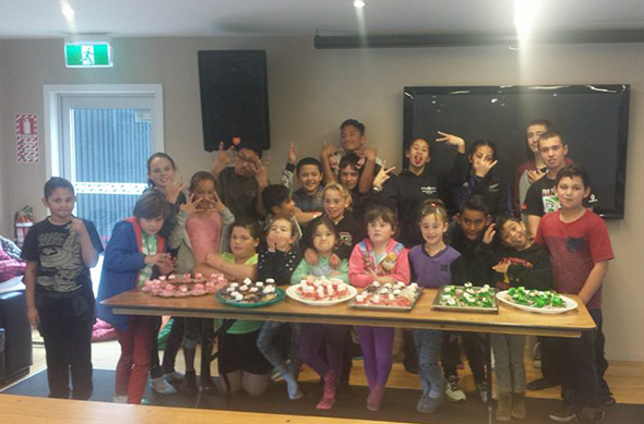 Tamariki with their home-made baking creations.
