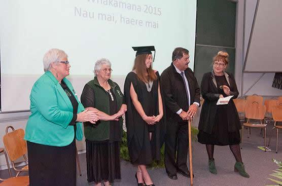 Te Taumutu Rūnanga members with one of the graduates.