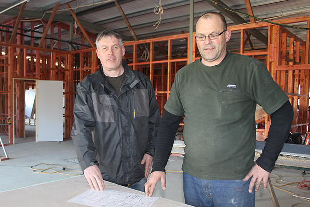 Hokonui Rūnanga Financial officer, Terry Nicholas (left) discusses progress on the $1.4 million rebuild of the Rūnanga's Charlton Rd complex with Archer Construction forman, Travis Watt.