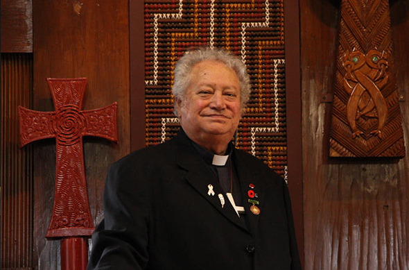 The Venerable Richard Wallace stands at the altar in the chapel of Te Waipounamu Diocesan Centre in Ōtautahi.