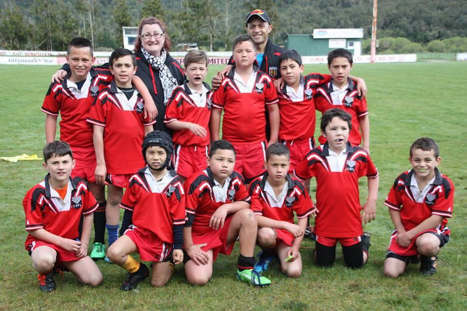 The boys with their rugby league team.