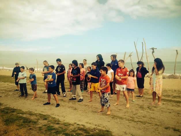 The Fusion crew performing on the Hokitika beachfront.