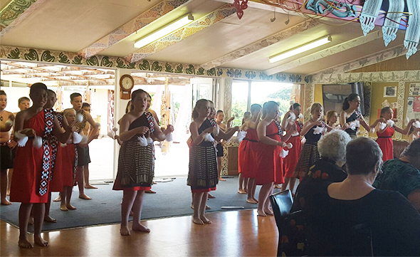 The kapa haka group treating the kaumātua to a performance.