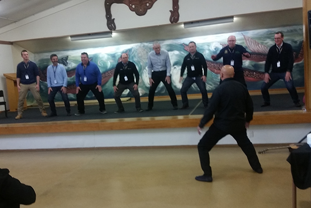 The men doing the haka on-stage.