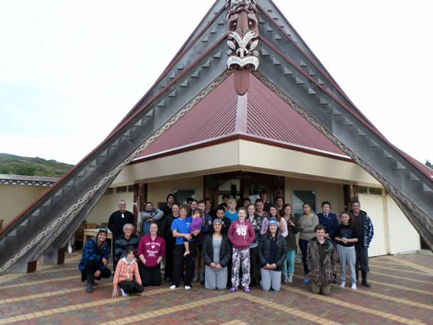 The rōpū gathered at the front of the whare, Tahu Potiki at Awarua Marae in Bluff.