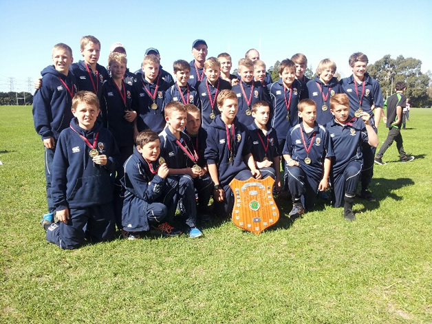 The team with their medals and winning shield.