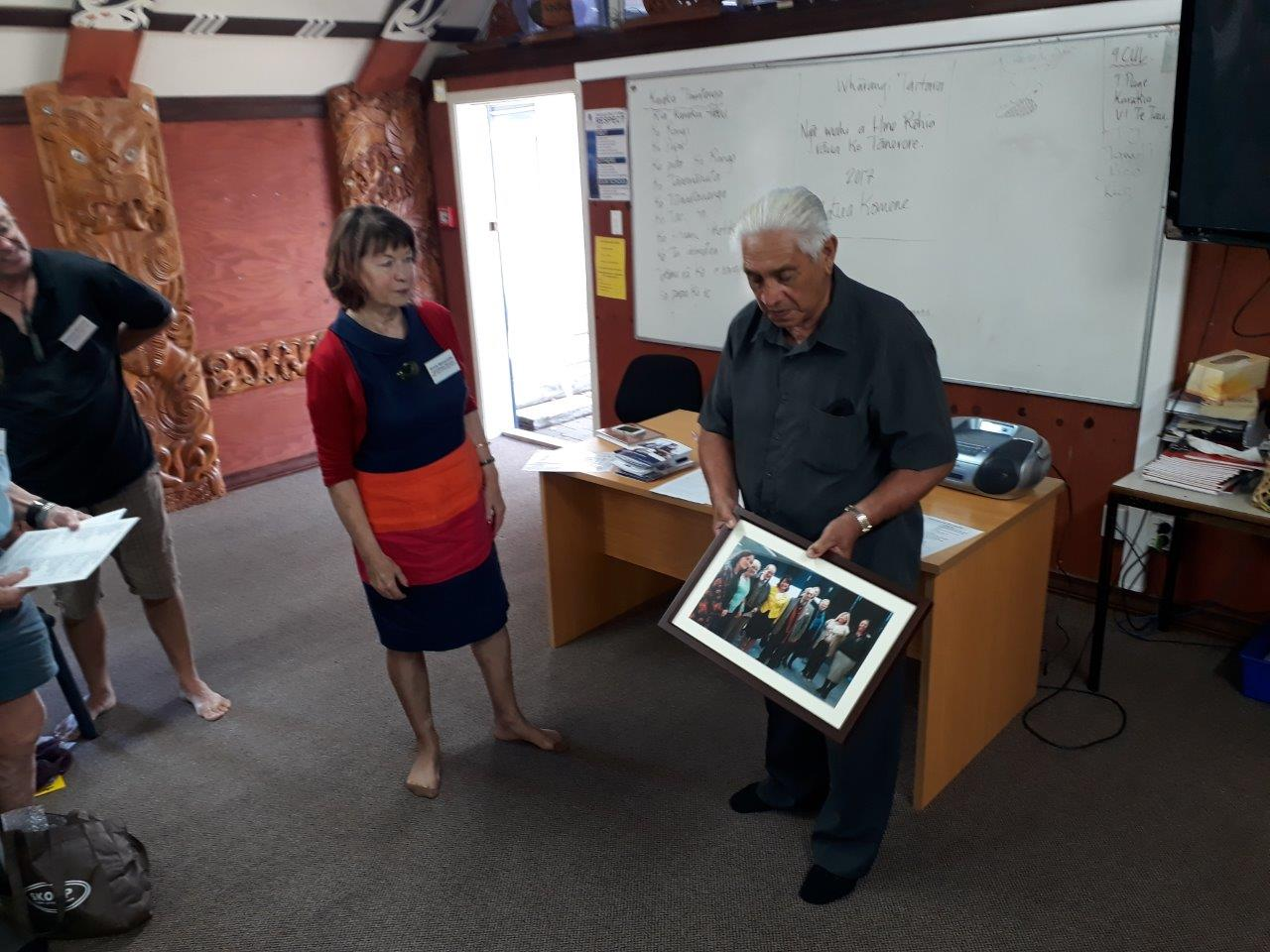 Uncle Joe showing the rōpū a photo of Laurie Lopers visit to Te Waipounamu.